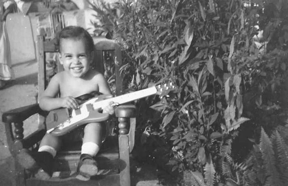 Frank Suarez as a small child playing guitar.jpg
